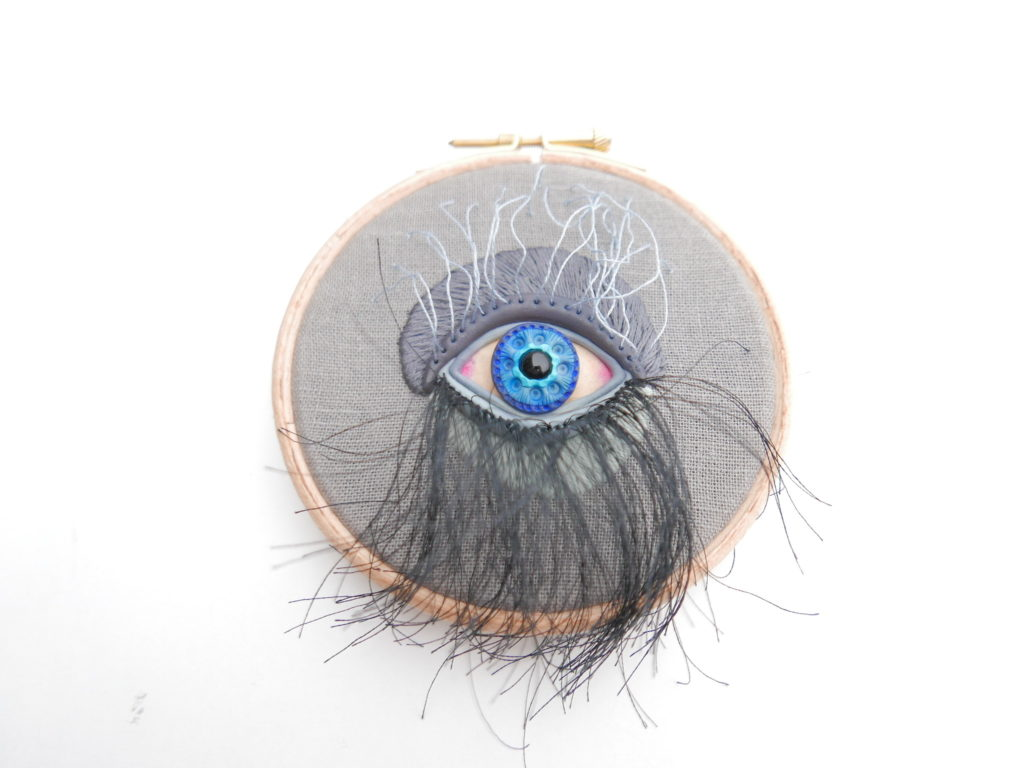 polymer clay eye hand embroidered on a hoop