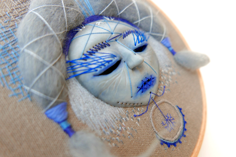 close up of hand embroidered mask