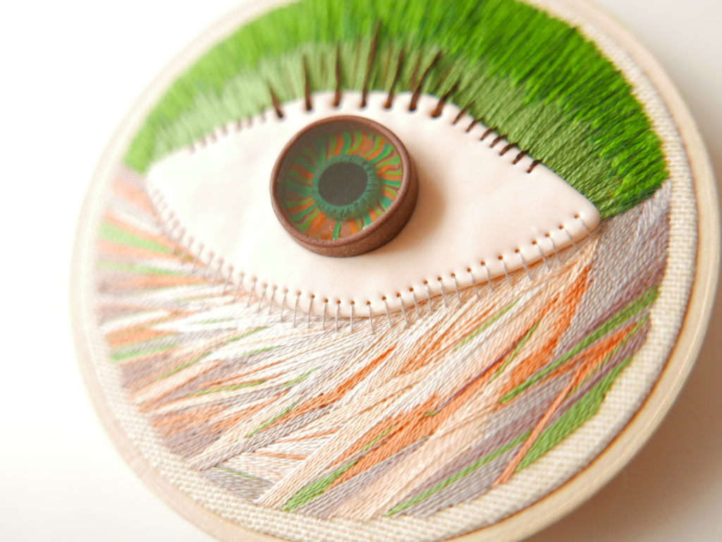 Hand embroidered polymer clay eye on a hoop