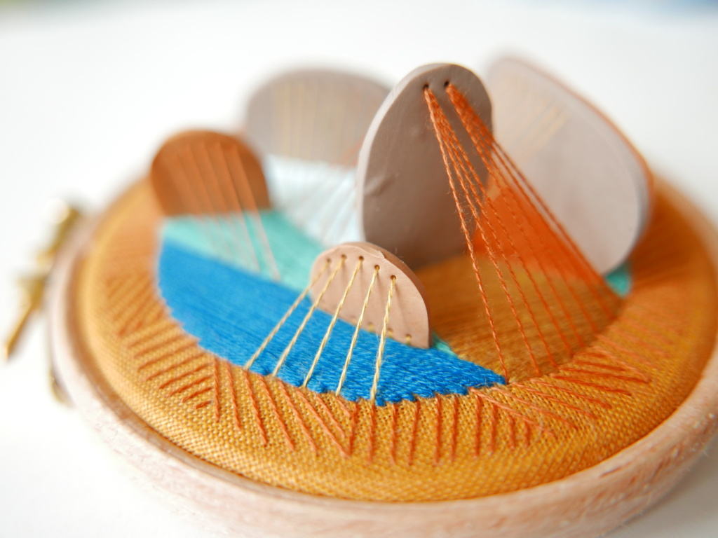 tiny polymer clay tiles stitched to a hoop