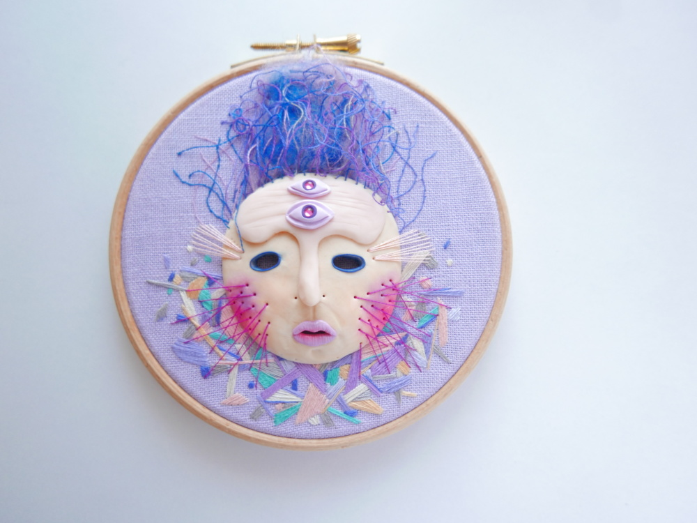 hand embroidered mask on a hoop