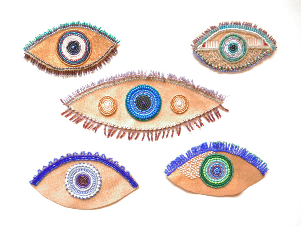 hand beaded eyes on recycled leather