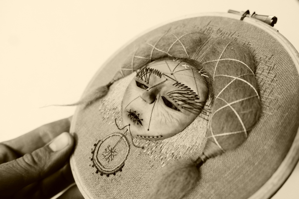 Hand embroidered mask with hair