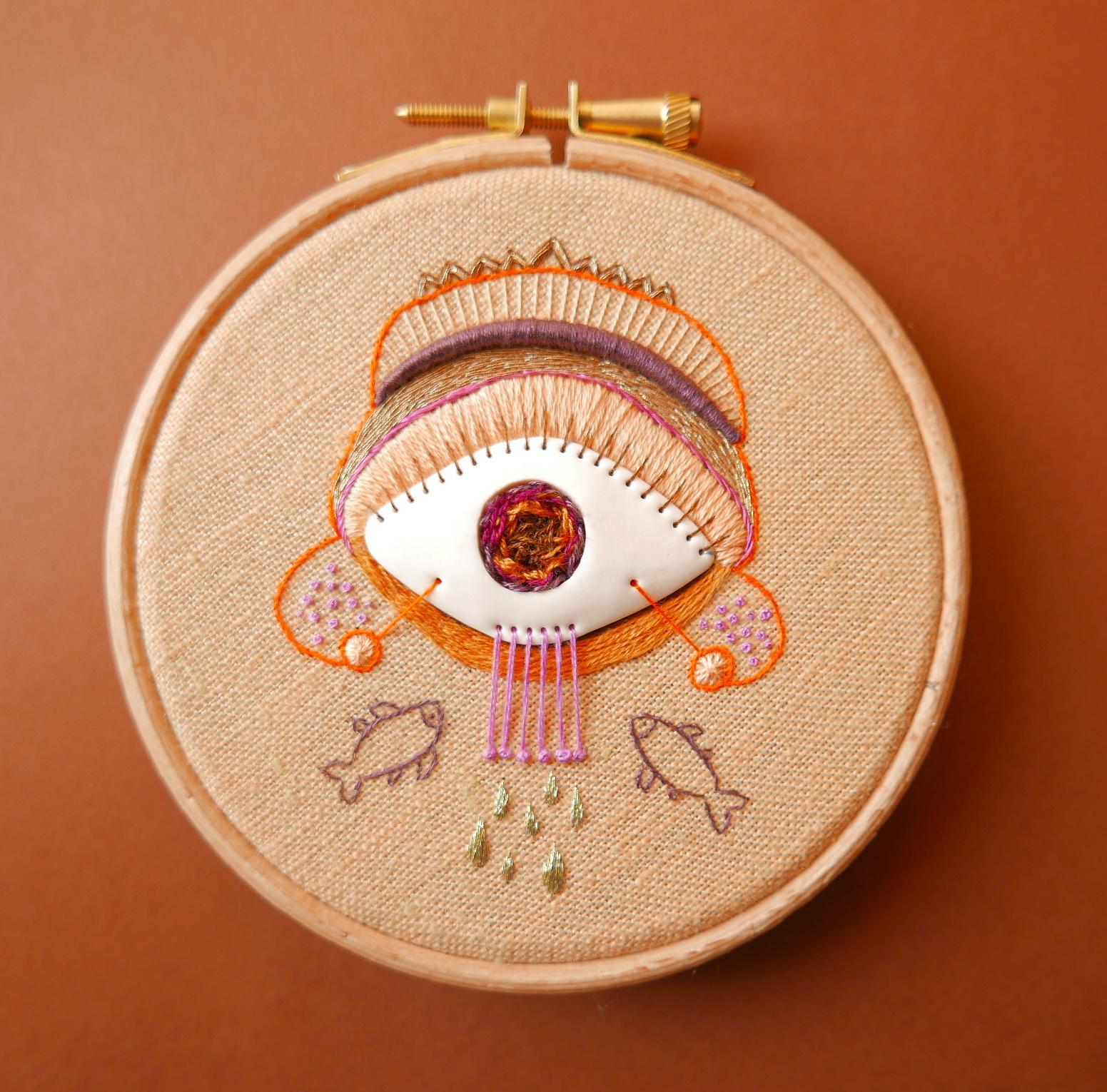 eye, fish on a hoop